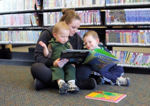 A mom sharing her favorite books with her children.