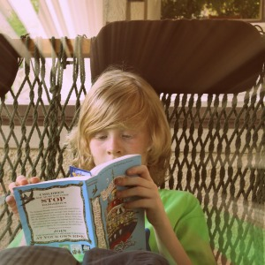My son, reading outside.